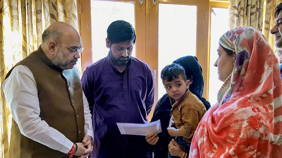 Home Minister Amit Shah Thursday visited the family of Jammu and Kashmir Police inspector Arshad Ahmed Khan, who was killed in a terror attack in Anantnag on June 12. Khan, 37, was injured in the terror attack and later flown to Delhi in an air ambulance for specialised treatment. However, he succumbed to injuries at the All India Institute of Medical Sciences (AIIMS) (PTI)