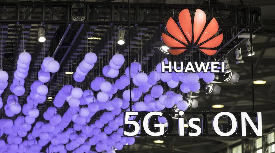 Signage is displayed at the Huawei Technologies Co. booth at the MWC Shanghai exhibition in Shanghai, China, on Thursday, June 27, 2019. The Shanghai event is modeled after a bigger annual industry show in Barcelona.