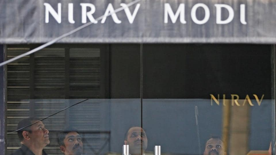 Security guards stand inside a Nirav Modi showroom during a raid by the Enforcement Directorate. Swiss authorities have issued orders to freeze four bank accounts with deposit worth Rs 286 crore linked to billionaire jeweller Nirav Modi, a move that adds to the celebrity designer's troubles who is already in a London jail pending a decision on India's extradition request. (Adnan Abidi / REUTERS File)