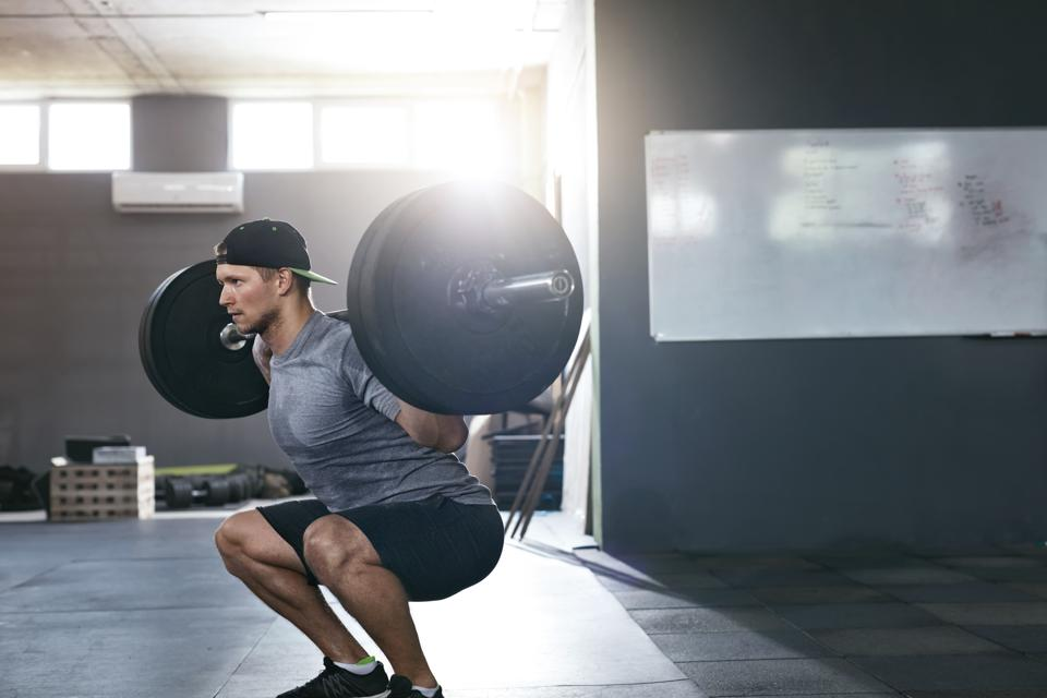 When you start lifting in a gym, it is imperative that you learn proper exercise form like in these barbell squats