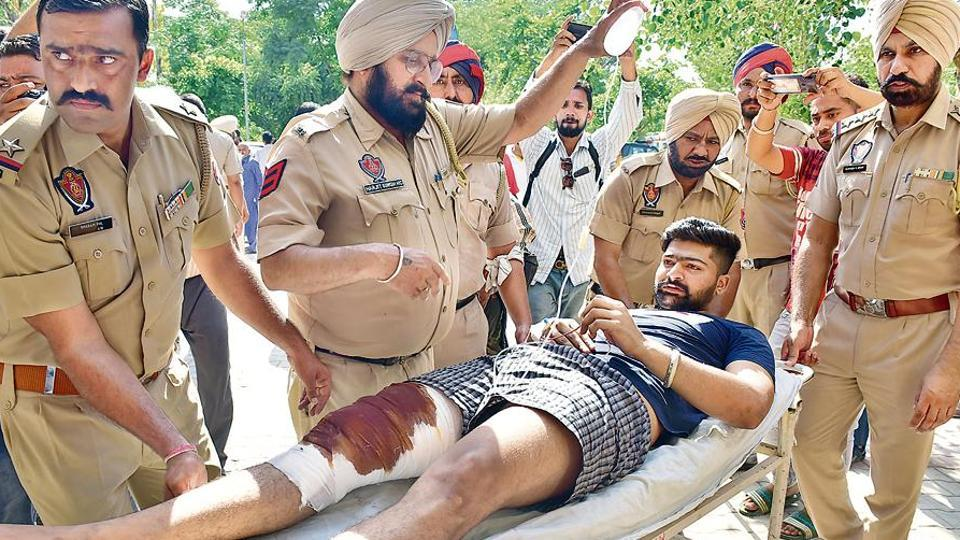 One of the injured inmates being brought to the civil hospital after the clash at the central jail in Ludhiana.