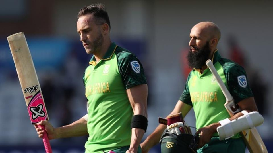 South Africa's Faf du Plessis and Hashim Amla walk off after winning the match against Sri Lanka.