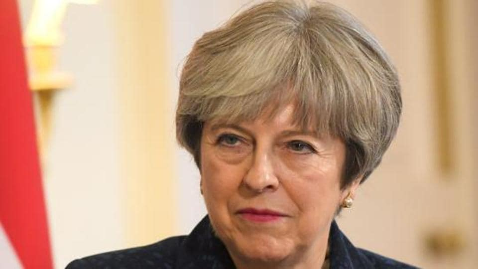 """British Prime Minister Theresa May told Vladimir Putin on Friday Russia must end its """"irresponsible and destabilising activity"""". (REUTERS/Toby Melville)"""