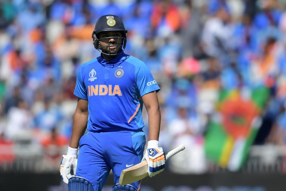 India's Rohit Sharma leaves the pitch after losing his wicket for 18 during the 2019 Cricket World Cup group stage match between West Indies and India at Old Trafford in Manchester, northwest England, on June 27, 2019. (Photo by Dibyangshu Sarkar / AFP) / RESTRICTED TO EDITORIAL USE