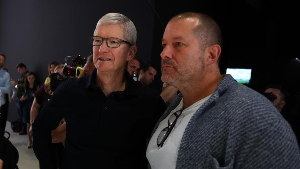 (FILES) In this file photo taken on June 3, 2019 Apple CEO Tim Cook (L) and Apple chief design officer Jony Ive (R) look at the new Mac Pro during the 2019 Apple Worldwide Developer Conference (WWDC)