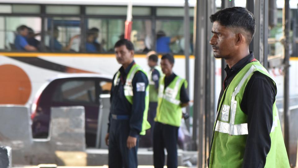 Employees at the Kherki Daula toll plaza, in Gurugram.