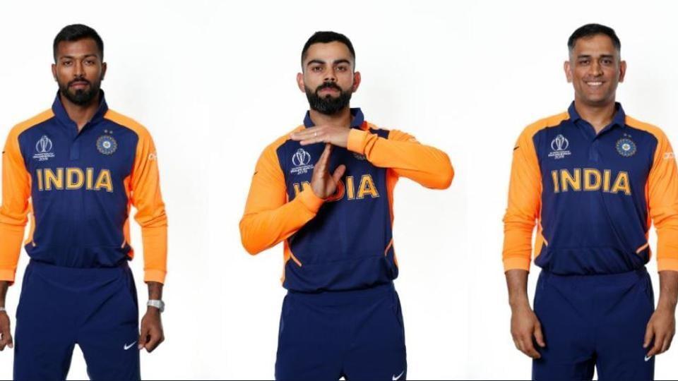 Hardik Pandya, Virat Kohli and MS Dhoni wearing India's new orange away jersey for their World Cup match against England