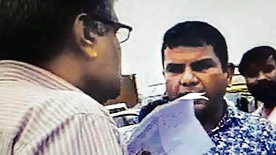 In a video grab, the suspect in blue shirt is seen arguing with the victim.
