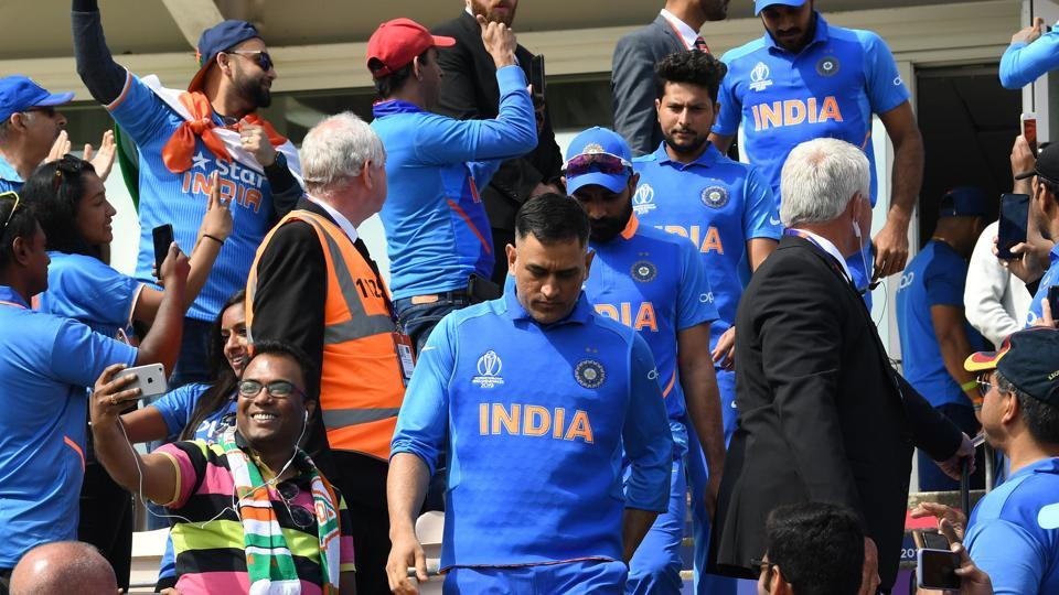 India's Mahendra Singh Dhoni (C) walks out onto the field ahead of the 2019 Cricket World Cup group stage match between India and Afghanistan at the Rose Bowl in Southampton, southern England, on June 22, 2019.