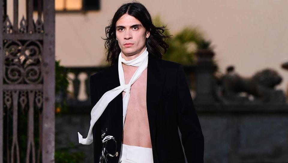 A model presents a creation during the presentation of French luxury fashion house Givenchy's new menswear collection, as Guest Designer of the Pitti Immagine Uomo fashion event on June 12, 2019 at Villa Palmieri in Fiesole, near Florence, Tuscany. (Photo by Miguel MEDINA / AFP)