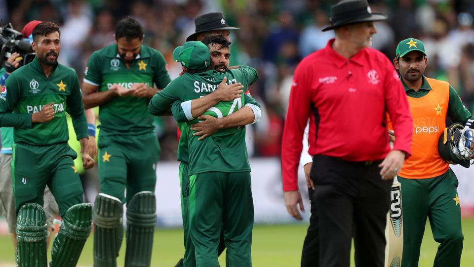 Pakistan's Sarfaraz Ahmed and team mates celebrate winning the match.