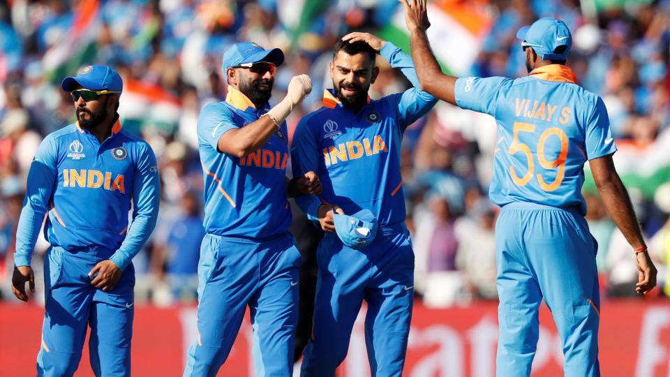 Cricket - ICC Cricket World Cup - West Indies v India - Old Trafford, Manchester, Britain - June 27, 2019 India's Virat Kohli celebrates with team mates after the match Action Images via Reuters/Lee Smith