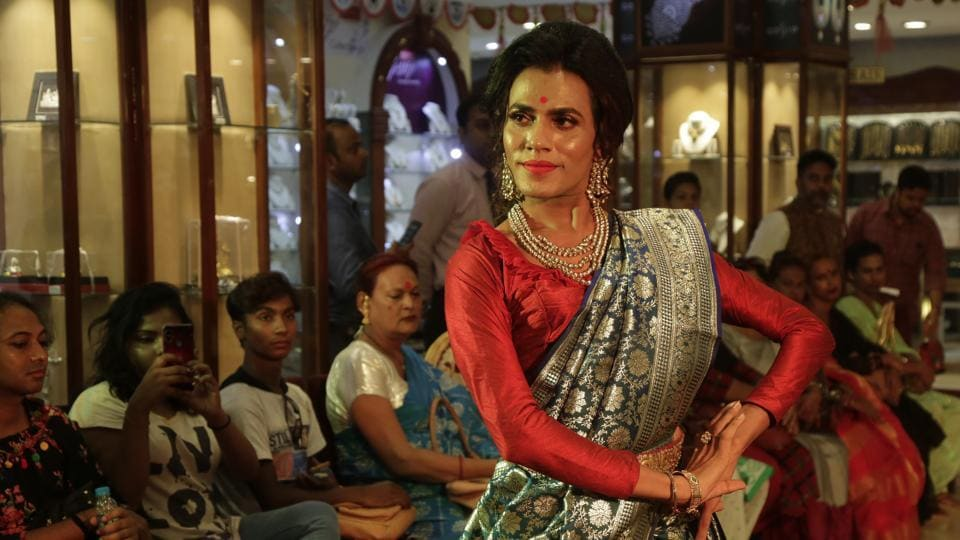 """Rintu walks the ramp during the Freedom of Expression fashion show in Kolkata, West Bengal. The """"Freedom of Expression"""" show featured a group of transgender persons dressed as mythological characters from Indian epics. (Bikas Das / AP)"""