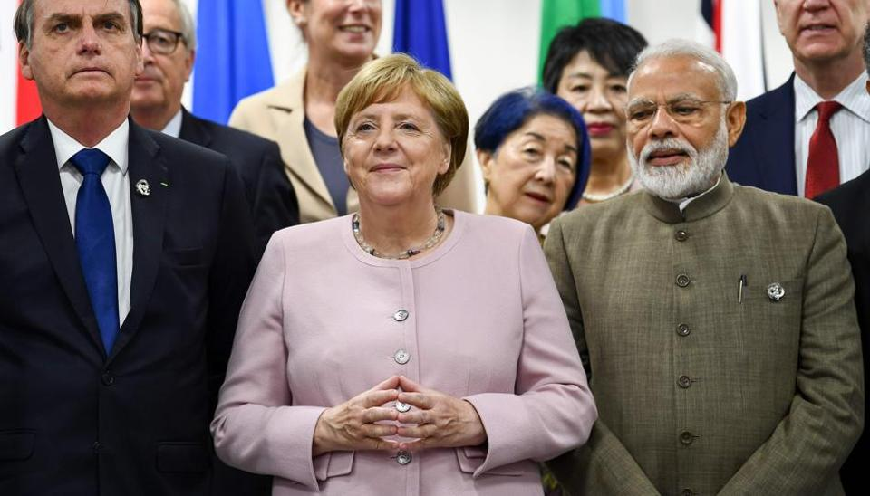 (L-R) Brazil's President Jair Bolsonaro, Germany's Chancellor Angela Merkel and India's Prime Minister Narendra Modi attend an event on women's empowerment during the G20 Summit in Osaka on June 29, 2019.
