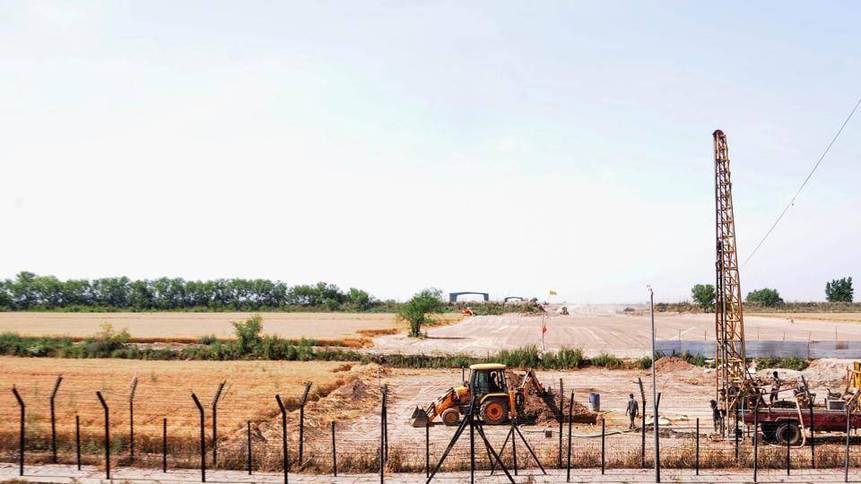 Heavy machines at work beyond the border fence for the construction of the Indian side of Kartarpur corridor, in Gurdaspur district, Monday, April 29, 2019.