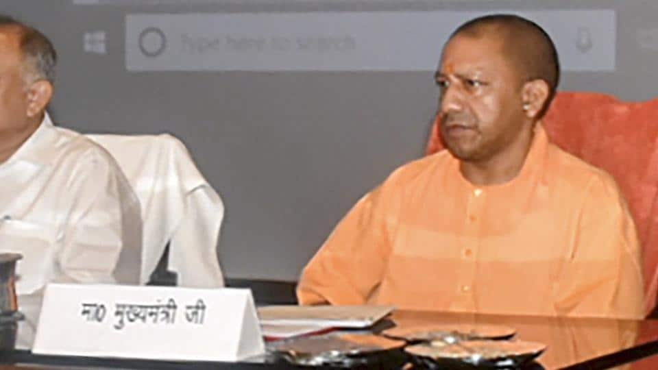 Lucknow: Uttar Pradesh Chief Minister Yogi Adityanath during a review meeting on law and order situation with senior officials at Lok Bhawan, in Lucknow, Wednesday, June 12 2019. (PTI Photo/Nand Kumar) (PTI6_12_2019_000142B)