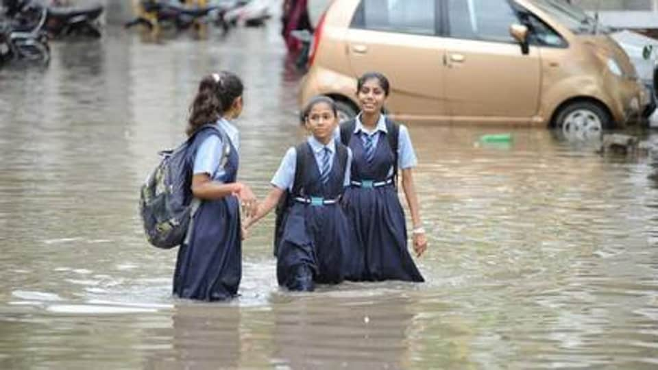 The national highway connecting Mumbai to Surat was under water on some stretches, causing traffic snarls.