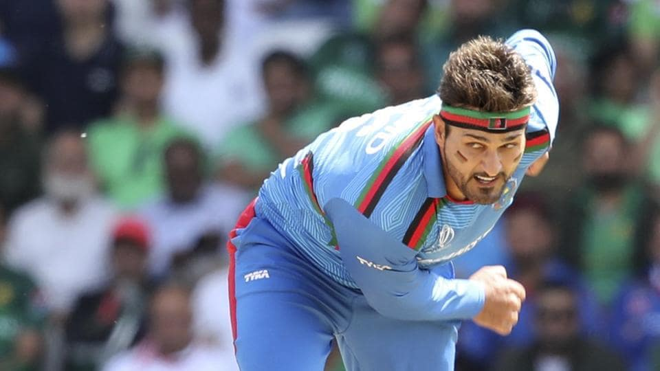 Afghanistan's Hamid Hassan bowls during the Cricket World Cup match.