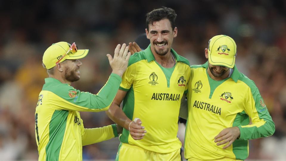 Australia's Mitchell Starc, centre, celebrates with teammates.