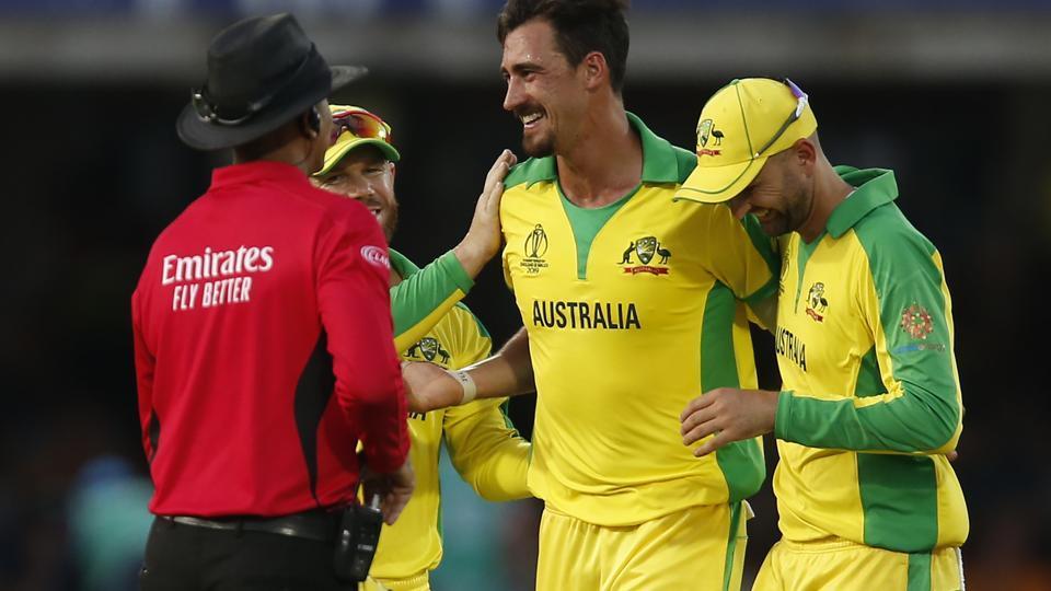 Australia's Mitchell Starc (C) celebrates with teammates.