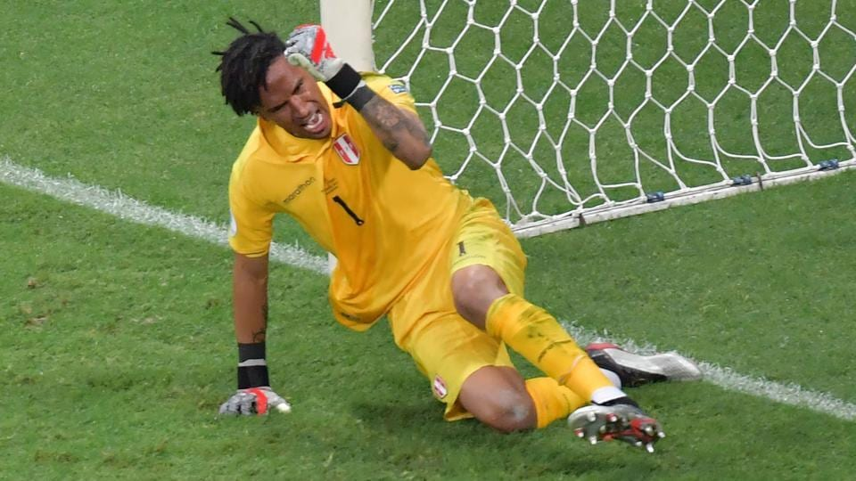 Peru's goalkeeper Pedro Gallese celebrates after stopping the penalty taken by Uruguay's Luis Suarez.