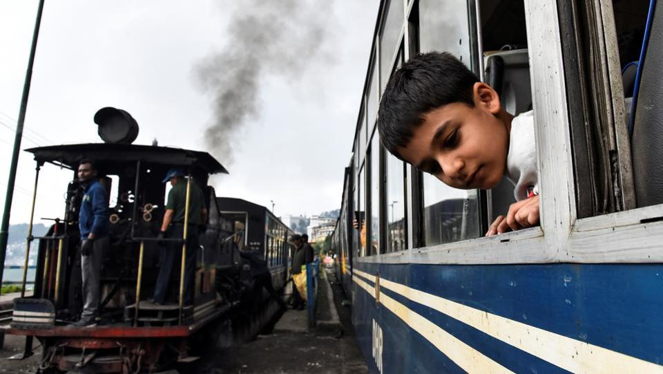 A boy looks out of a DHR train. It is polpularly known by the name 'Toy Train' whis is in fact never an official term it is just a popular expression found in literature. Like tea and the Ghurka culture, the DHR has become an essential feature of the landscape and an enduring part of Darjeeling's identity. (Ranita Roy / REUTERS)