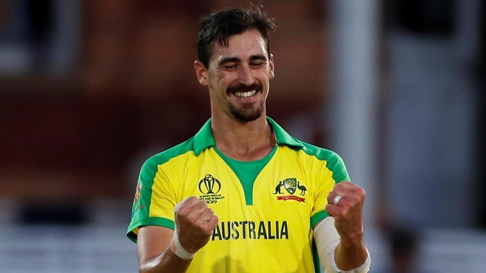 Australia's Mitchell Starc celebrates after taking the wicket of New Zealand's Mitchell Santner.