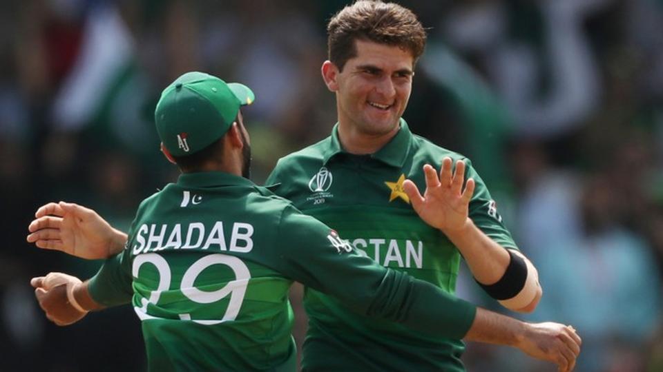 Pakistan's Shaheen Afridi and Shadab Khan celebrate taking the wicket of Afghanistan's Najibullah Zadran.