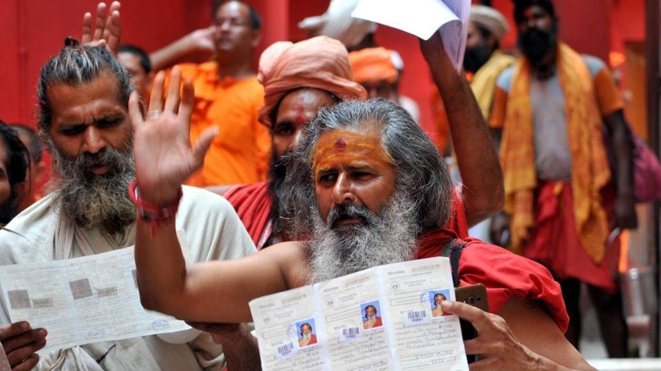 Jammu, India - June 29, 2019: Sadhus wait to get themselves registered for an annual pilgrimage on the first day of registration for Amarnath Yatra at Ram Mandir Base Camp, in Jammu, Jammu and Kashmir, India, on Saturday, June 29, 2019. The 40-day pilgrimage yatra to the cave shrine at an altitude of 3,880 metre in the south Kashmir Himalayas will commence from both the routes from July 1. (Photo by Nitin Kanotra / Hindustan Times)