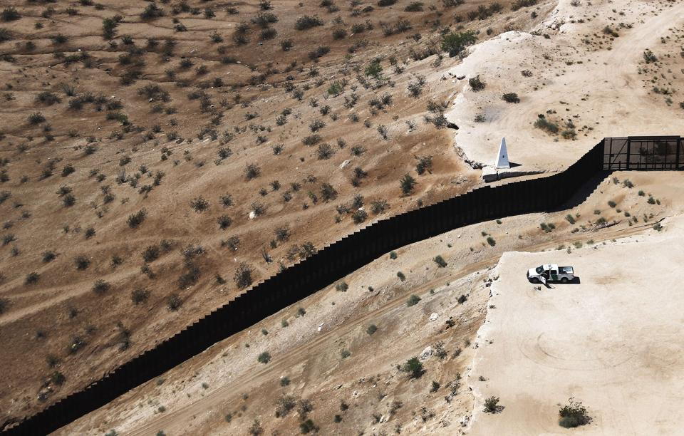 An aerial view of a U.S. Border Patrol vehicle positioned next to the U.S.-Mexico border barrier on June 28, 2019 in Sunland Park, New Mexico.