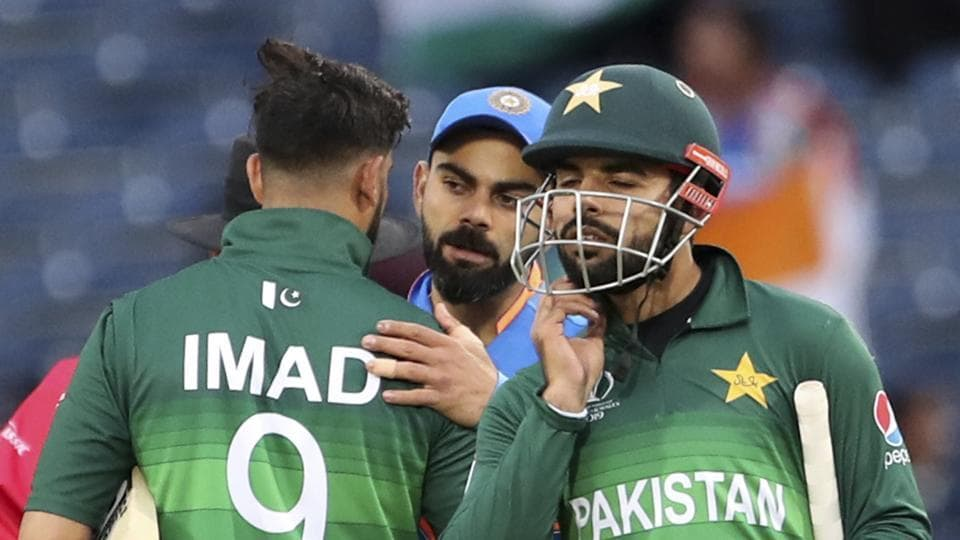 India's captain Virat Kohli, center, greets Pakistan players at the end of the Cricket World Cup match between India and Pakistan at Old Trafford in Manchester, England, Sunday, June 16, 2019.