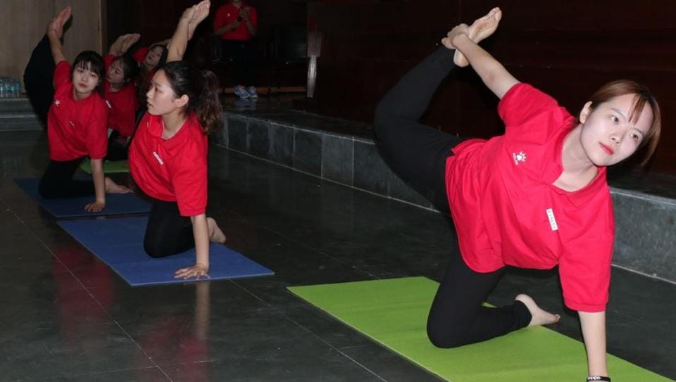 Chinese students, faculty learn Yoga at Sharda University in Greater Noida