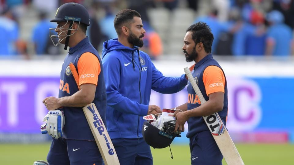 India's captain Virat Kohli (C) greets his players Mahendra Singh Dhoni (L) and Kedar Jadhav (R) as they walk off the field after defeat in the 2019 Cricket World Cup group stage match between England and India at Edgbaston in Birmingham, central England, on June 30, 2019.