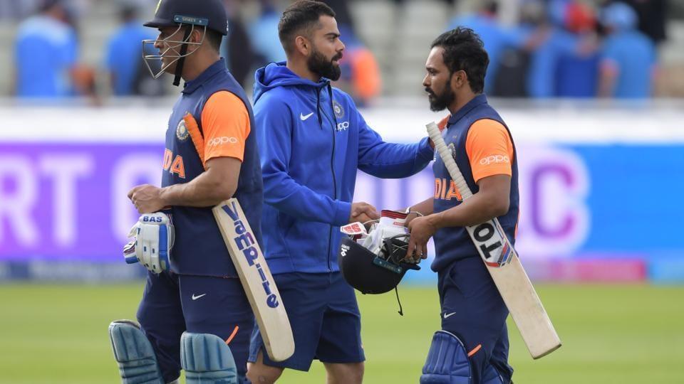 India's captain Virat Kohli (C) greets his players Mahendra Singh Dhoni (L) and Kedar Jadhav (R.
