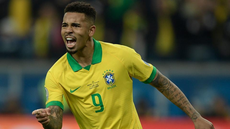 Brazil's Gabriel Jesus celebrates after scoring his penalty to defeat Paraguay.