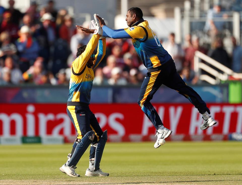 Sri Lanka's Angelo Mathews celebrates after taking the wicket of West Indies' Nicholas Pooran.