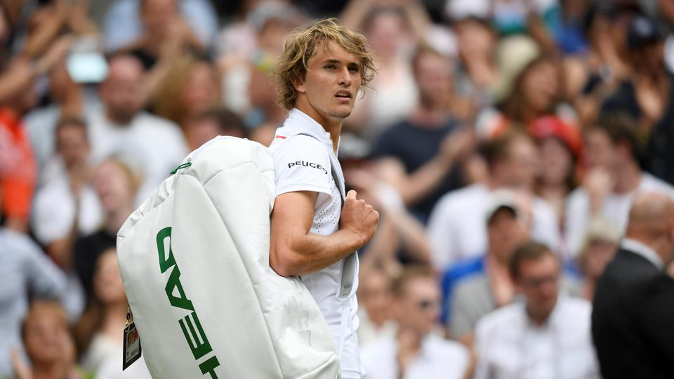 Germany's Alexander Zverev walks off court after losing his first round match.