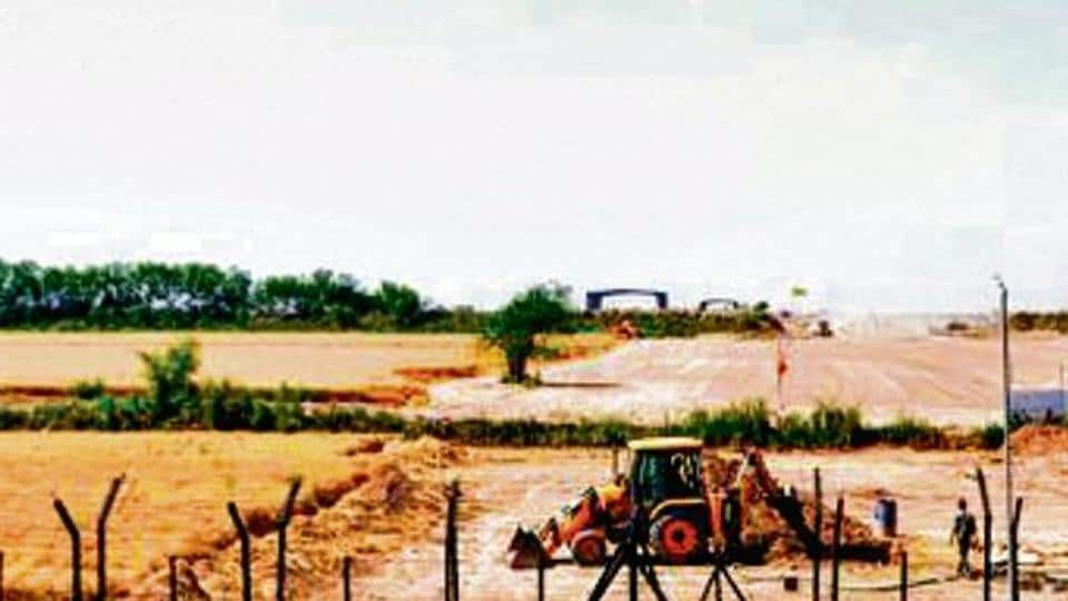 Heavy machines at work beyond the border fence for the construction of the Indian side of Kartarpur corridor, in Gurdaspur