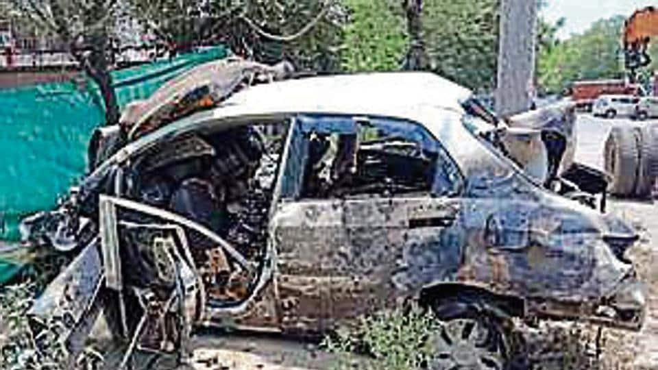 The car was charred in the incident.