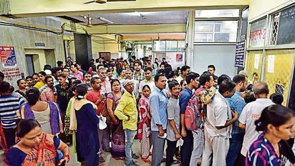 Patients stand in queue inside the Hindu Rao Hospital as doctors are on strike, in New Delhi, India, on Monday, July 01, 2019. Doctors abandoned work after a relative of a patient allegedly attacked a doctor at Malka Ganj.