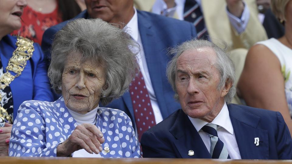 Former F1 world champion Sir Jackie Stewart and Victoria Stewart take their seats on Centre court on Monday. Big names packed the royal box on Day 1 but only one Royal family member, Prince Edward --who presents the trophy to winners every year-- was present and representing. The hotly anticipated tournament runs until July 14. (Kirsty Wigglesworth / AP)