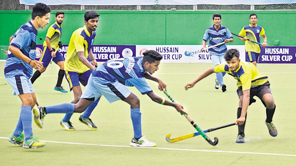 Priyadarshani (yellow) were on the backfoot from the first minute versus Rovers Academy 'A' (blue ) during the Hussain Silver Cup hockey tournament played at Major Dhyanchand stadium, Pimpri, on Monday.
