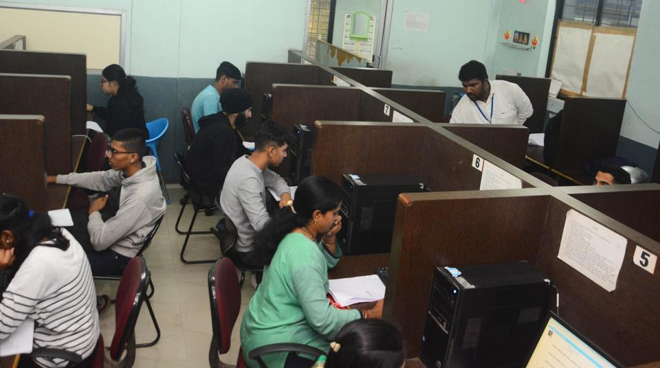 People appearing for the learning licence test at the examination hall at RTO in Pune.