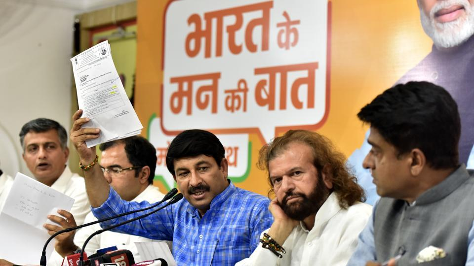 Delhi Bharatiya Janta Party (BJP) President Manoj Tiwari addresses a press conference on corruption charges against AAP government's claim of school classroom renovation in the presence of BJP MP from West Delhi Parvesh Verma, BJP MP from North West Delhi Hans Raj Hans and other senior leaders, at BJP office, in New Delhi, India, on Monday