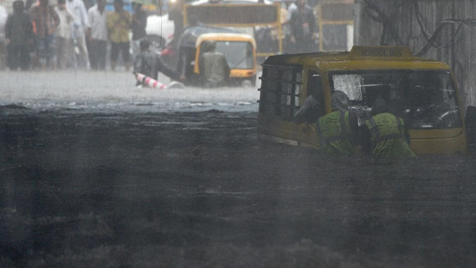 People deal with waterlogging at Andheri Subway(W) in Mumbai, India, on Monday, July 1, 2019.