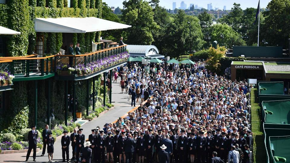 Spectators queue, in true British style, to enter The All England Tennis Club in Wimbledon on the first day of the 2019 Wimbledon Championships. Only a limited number of tickets are available daily for Centre Court and courts No. 1 and No. 2, except for the last four nailbiting days when all are sold in advance. (Daniel Leal-Olivas / AFP)