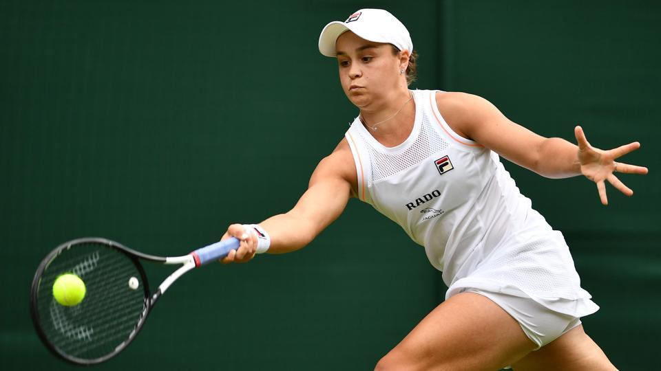 Australia's Ashleigh Barty returns against China's Zheng Saisai during their women's singles first round match on the second day of the 2019 Wimbledon Championships.