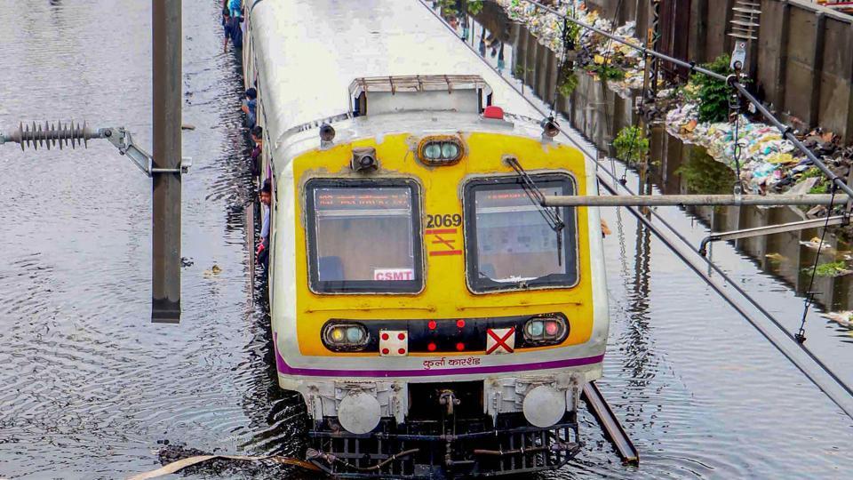 Mumbai: A suburban local train wades across submerged railway tracks following heavy monsoon rains, in Mumbai.
