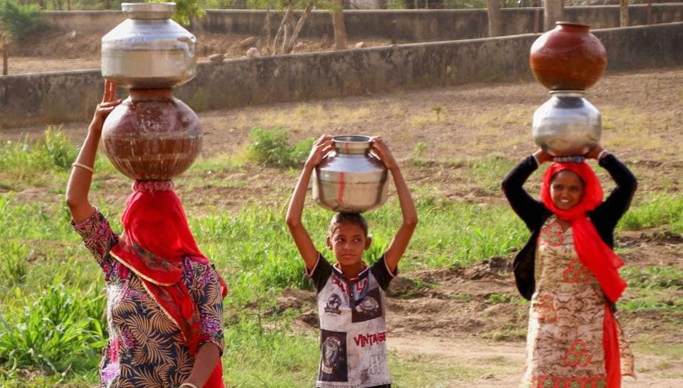In many places in Rajasthan women have to walk long distances to collect water.