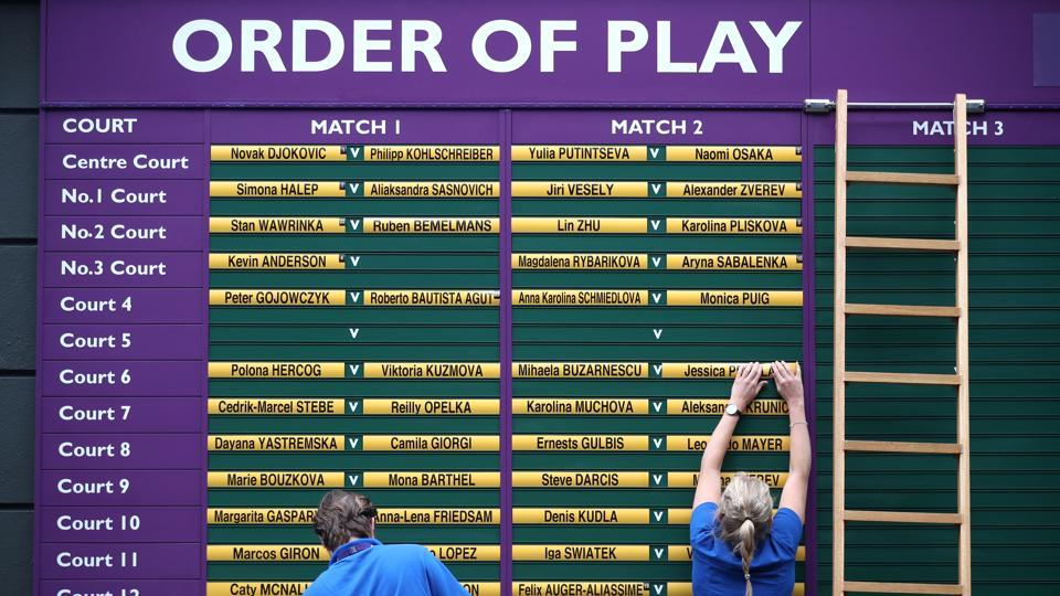 The Order of Play board is prepared at the All England Lawn Tennis and Croquet Club. Naomi Osaka's 16-match Grand Slam winning streak has been followed by a two-match losing streak at majors. On a wild Day 1 at the All England Club, No. 2 Osaka was the highest-seeded and most-accomplished player to leave the scene, beaten 7-6 (4), 6-2 by Yulia Putinseva. (Hannah McKay / REUTERS)